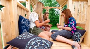 3_tweens_in_outdoor_playset.jpg